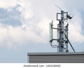 A simple technical shot of an single typical receiving and transmitting cellular LTE mobile communications antenna, blue sky as a background. Radio propagation and wireless communication concept