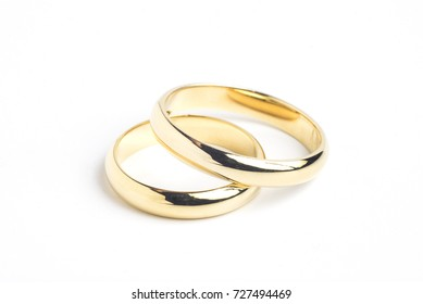 Simple traditional curved gold wedding rings.