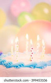 Simple white Birthday cake with cake candles.