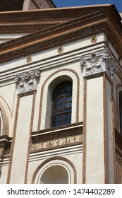 Simple window with fake decorative columns, catholic cathedral in italy