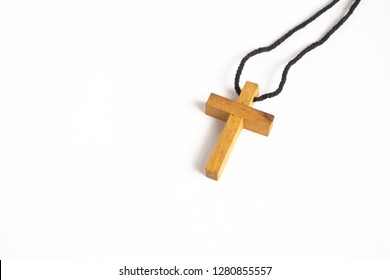 Simple Wooden Cross Necklace on iSolated White Background.