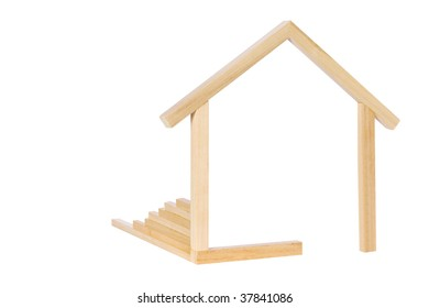 A simple wooden frame in the shape of a house.  Symbol for new home construction.  Something a little different.  Isolated on white.