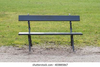 Simple wooden garden bench in a park