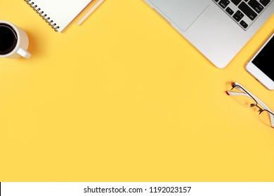 simple workspace technology desk with laptop computer and copy space on yellow pastel background