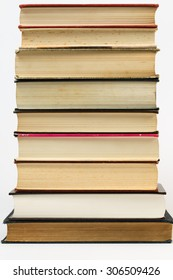 A simple yet eloquent pile of books. With a plain white background, this is a nice photo that has many educational applications for various ideas and concepts around the world.