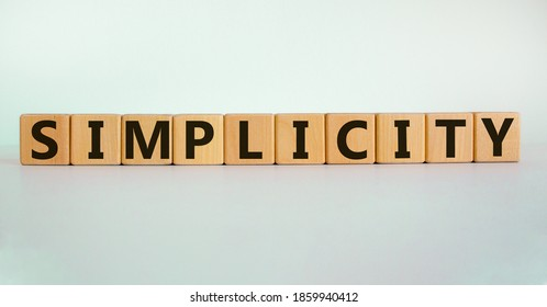 Simplicity concept. Wooden cubes with word 'simplicity'. Beautiful white background. Business and simplicity concept, copy space.
