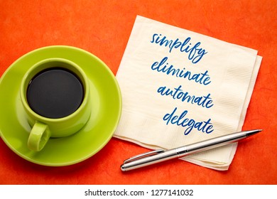 simplify, eliminate, automate, delegate productivity concept - inspirational handwriting on a napkin with a cup of coffee