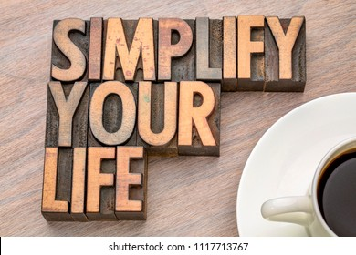 simplify your life advice - word abstract in vintage letterpress wood type with a cup of coffee