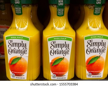 Simply Orange, high pulp, non gmo, organic on display in the refrigerated section of a grocery store.