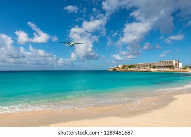 Simpson bay, Saint Maarten - December 17, 2018: A airplane landing at the Princess Juliana International Airport flying low over water at Maho Beach in Saint Martin, Dutch Antilles, Caribbean.
