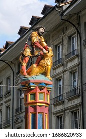 Simsonbrunnen Fountain in the center of Bern, Switzerland. The colorful statue of the biblical character Samson killing a lion