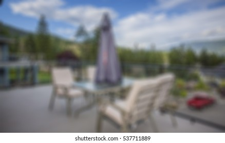 simulated out of focus blurry view of a residential building outdoor patio