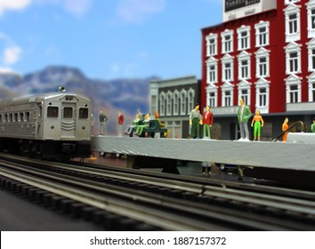A simulation of an arriving commuter train using a model train layout.