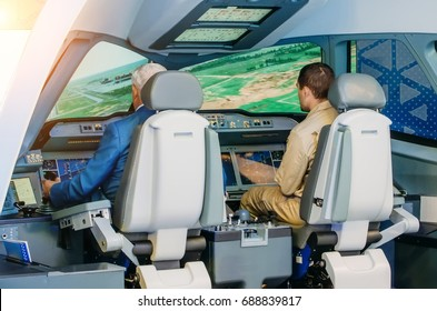 The simulator of a passenger aircraft with a cockpit and pilots