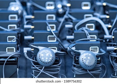 Simultaneous translation devices. Dark background of technical devices. Audio guide. Devices for listening to excursions. Individual electronic translators.