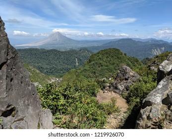 Sinabung vulcano seen from Mount Sibayak in Berastagi, Indonesia