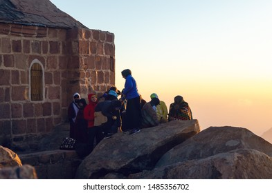 Sinai Peninsula, Egypt, May 9, 2019: Pilgrims meet the dawn on the Moses Mountain, Sinai Peninsula, Egypt