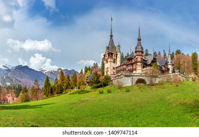 SINAIA, ROMANIA - 27.04.2019: Peles Castle, Sinaia, Prahova County, Romania: Famous Neo-Renaissance castle in autumn colours, at the base of the Carpathian Mountains, Europe
