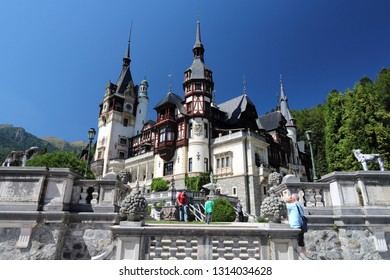 SINAIA, ROMANIA - AUGUST 20, 2012: People visit Peles Castle in Sinaia, Romania. The castle was completed in 1914. It is ranked no. 1 tourism attraction in Southern Romania by Tripadvisor.