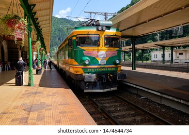 Sinaia, Romania, August 5, 2019.  The Astra trans carpatic train pulls into the Sinaia station, as people on platform get ready to board