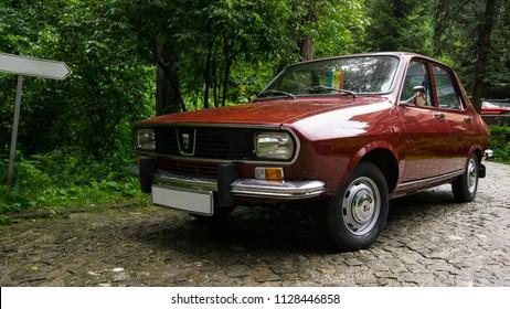 SINAIA, ROMANIA - JUN 30, 2018: Dacia 1300 parked near the forest