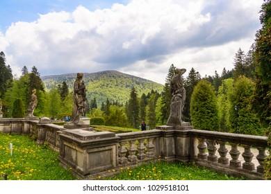 SINAIA, ROMANIA - JUNE 5, 2017: Statue at the Peles Castle, a Neo-Renaissance castle in the Carpathian Mountains, Sinaia, Prahova County, Romania