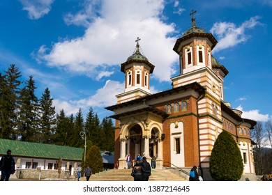 Sinaia, Romania - March 09, 2019: People visiting Sinaia Monastery located in Sinaia, Prahova county, Romania.