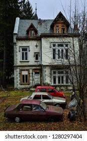 SINAIA, ROMANIA - NOVEMBER 7, 2018. Sinaia documentary project. Abandoned house and vintage cars in the center of Sinaia, Prahova Valley.