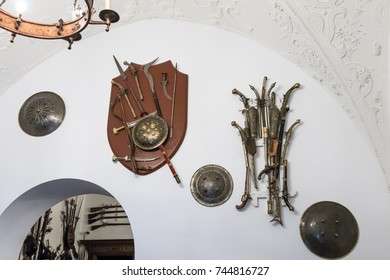Sinaia, Romania, October 05, 2017 : Weapons hanging on the wall in the inner room of the Peles castle in Sinaia, in Romania