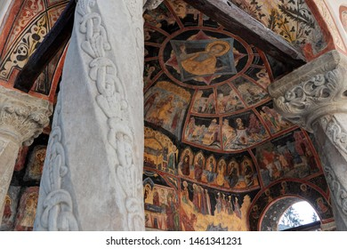 Sinaia, Romania - October 26, 2018: details of frescoes on the Old Church (Biserica Veche) roof, in Sinaia Monastery