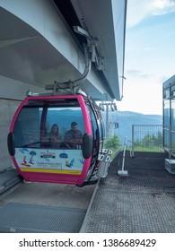 Sinaia/Romania - June 02 2018: People inside one gondola at the 1400 station of the Gondola in Sinaia. The station was opened in 2007.