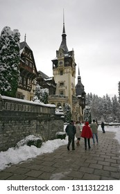 Sinaia/Romania - November 11 2005: Tourists at the Peles castle, Sinaia, Romania during winter. Peles is a Neo-Renaissance castle in the Carpathian Mountains, near Sinaia, in Prahova County.
