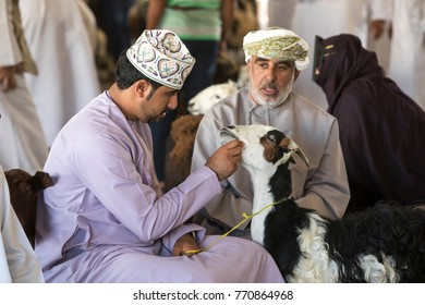 Sinaw, Oman, November 30th, 2017: people buying and selling goats at a market