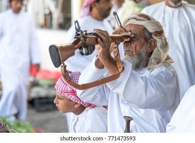 Sinaw, Oman, November 30th, 2017: man with a rifle at a gun market