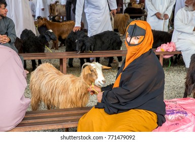 Sinaw, Oman, November 30th, 2017: woman with her  goat at a market