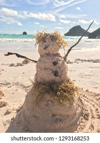 Since it was snowing at hone, we built a cute snowman out of sand at the beach in beautiful Bermuda while on vacation in the month of January at Horseshoe Bay Beach