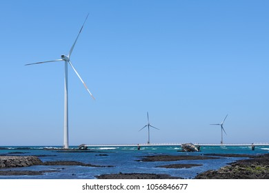 Sinchang windmill farm, coastal road with wind turbines located at Hangyeong-myeon. It is popular as a driving course and is famous for its bridge over the sea.