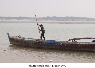 Sindh Pakistan 2020, a small boy doing fishing and boat in river indus, labour day, Asia, child labour