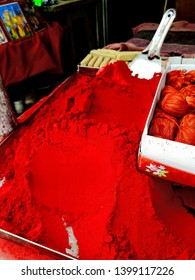 Sindoor (vermilion), Red, maroon powder of vermilion. Sign of a married woman in Hindu's or Indian's. Soft focus on vermilion.