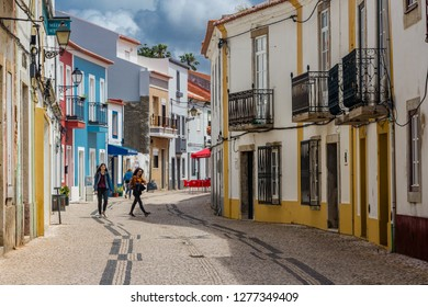Sines, Portugal - May 5, 2017: Narrow, picturesque, colorful cobbled stone street in the town of Sines, Portugal.