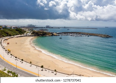 Sines, Portugal - May 5, 2017: Panorama view over Vasco da Gama beach in town of Sines. Turquoise water. Moody sky, clouds.