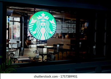Sing Buri , Thailand - June14,2020 : Exterior view of a Starbucks store in the city centre.