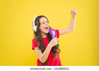 Sing lyrics. Child teen enjoy music playing in earphones. Little girl enjoying favorite music. Catch the rhythm. Kid listening music headphones. Entertainment and fun. Whole musical world in her ears.