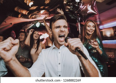 Sing. Men. Microphone.Great Mood. Sing in Karaoke. Karaoke Club. Celebration. Dance Club. Holidays Concept. Dancing People. Young People. Trendy Modern Nightclub. Party Maker. Birthday. Men. Have Fun.