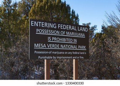 Sing in Mesa Verde National Park stating that in federal land possession of marijuana is prohibited even thou it might be legal at state Level.