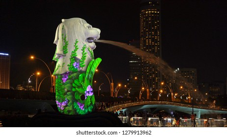 Singapore - 01/01/2019 : New Year Countdown 2019 at Merlion with colorful lights in Downtown Singapore City at night with skyscraper buildings background