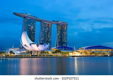 Singapore, 01/16/2018, Evening city. The main attraction of the Bay is the hotel, consisting of three 55-storey towers, United on top of one huge observation deck in the form of a boat.