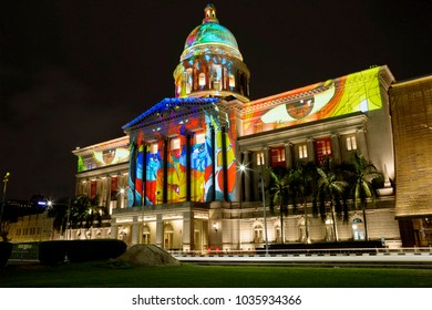 Singapore, 01/17/2018, Laser show on the walls of the national gallery. Color laser show on the walls of the national gallery of Singapore is accompanied by music and held every evening.