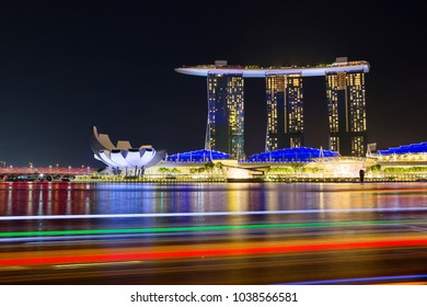 Singapore, 01/18/2018, Laser show on the waterfront of Marina Bay. The main attraction of the Bay is the hotel, consisting of three 55-storey towers, United on top of one huge observation deck.