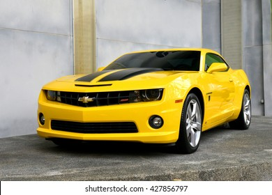 SINGAPORE - 06 MAY 2016: Real Size Yellow Chevrolet Camaro Car or Bumblebee Robot in Transformer Movie
